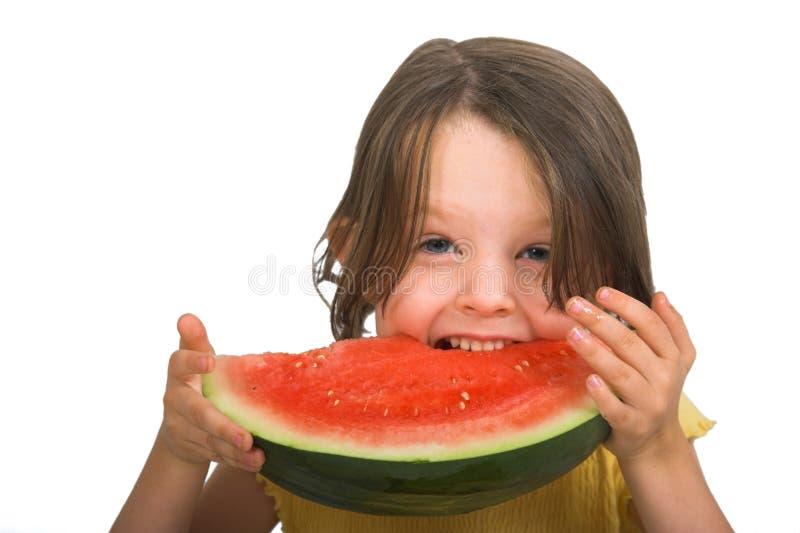 Bambina con l'anguria fotografia stock libera da diritti