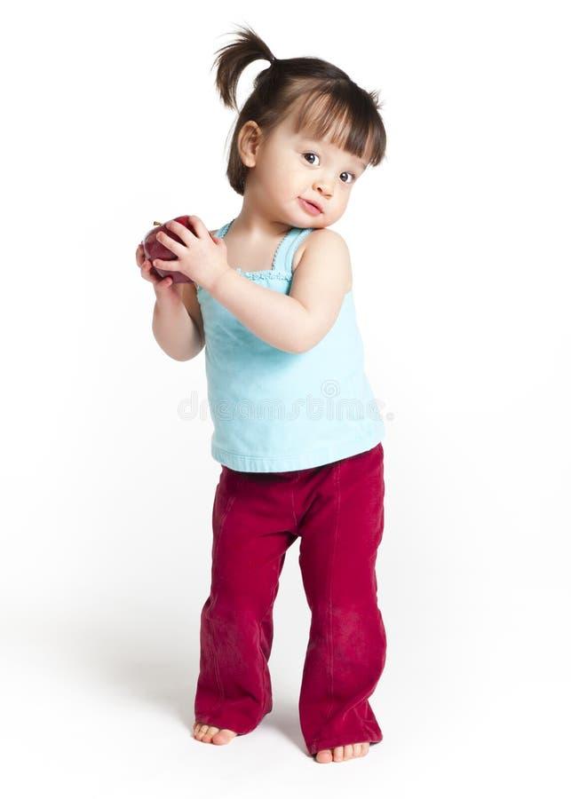 Bambina con la mela fotografia stock