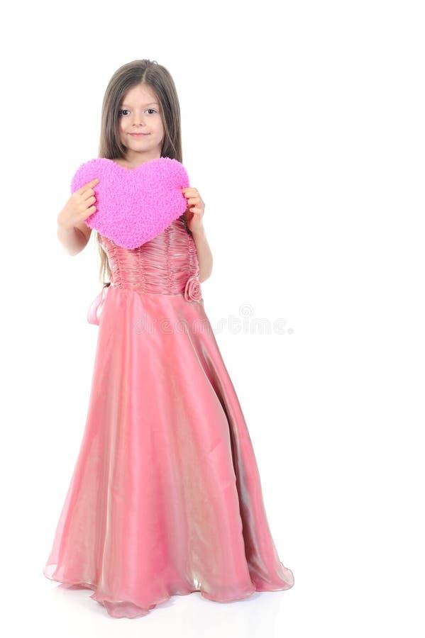 bambina con un bello cuore. immagini stock