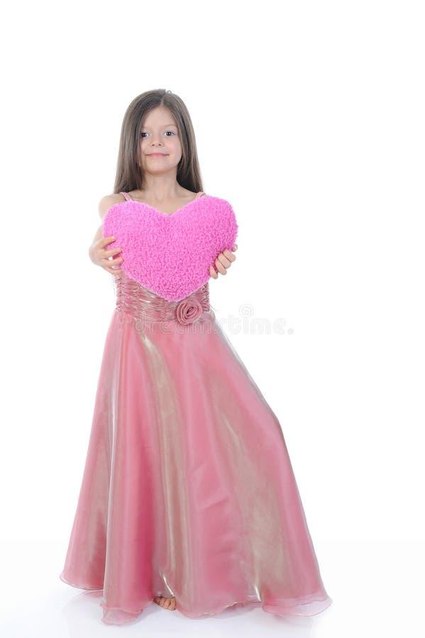 Bambina con un bello cuore immagini stock libere da diritti