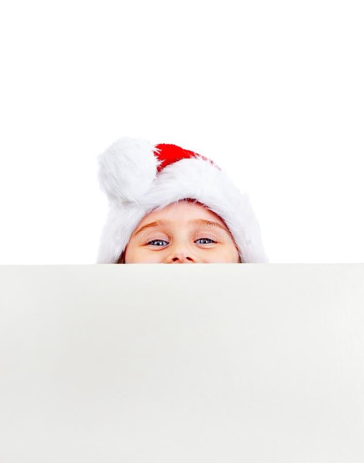 Bambina con un bordo in bianco fotografie stock