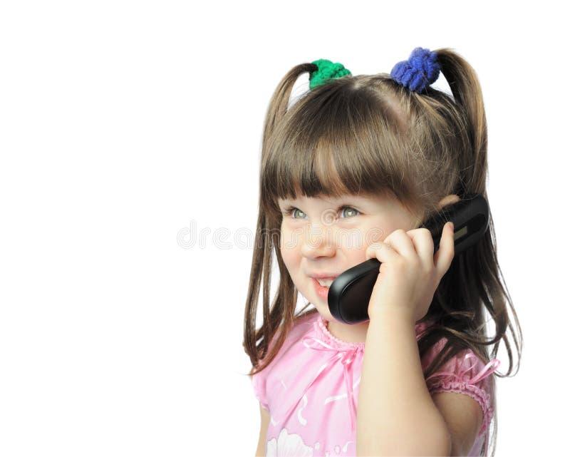 Bambina con un telefono mobile fotografie stock