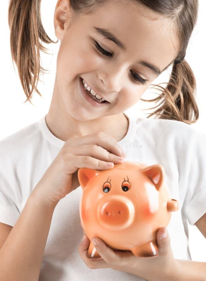 Bambina con una piggy-banca fotografie stock libere da diritti