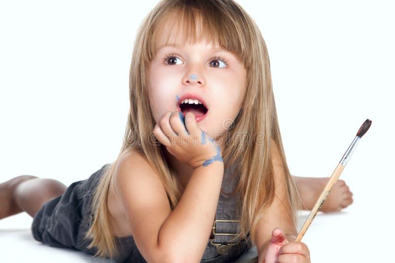 Bambina con una spazzola fotografie stock libere da diritti