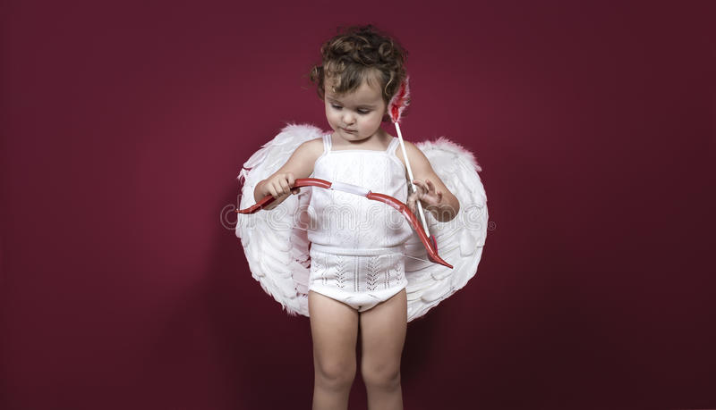 Bambina del cupido immagine stock