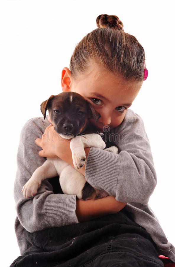 Bambina e cucciolo fotografia stock