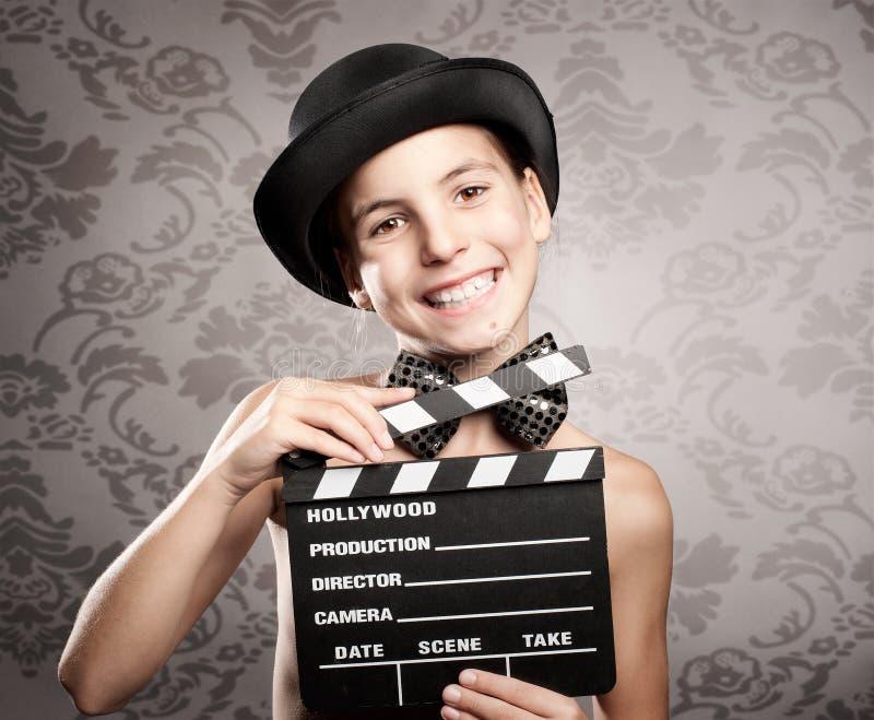 Bambina felice che tiene una valvola di film fotografia stock libera da diritti