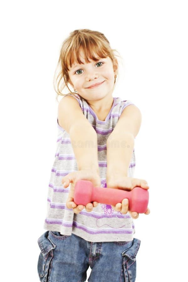 Bambina felice con il dumbbell immagini stock libere da diritti