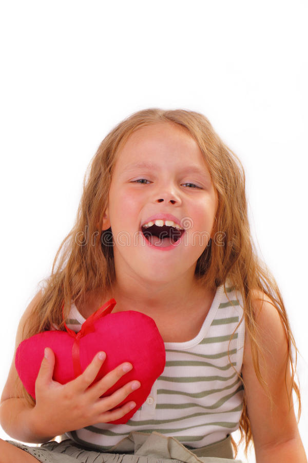 Bambina felice con un regalo per il San Valentino della st fotografia stock