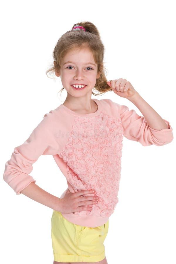 Bambina felice contro il bianco immagine stock