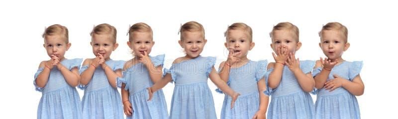 Bambina felice sveglia nelle pose differenti del ritratto fotografia stock libera da diritti