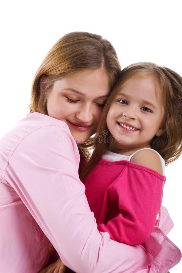 Bambina graziosa e la sua madre fotografia stock