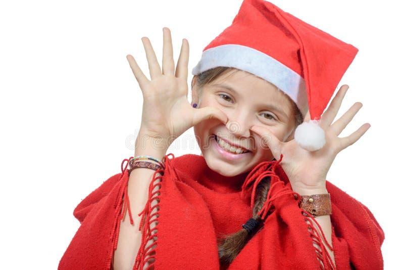 Bambina graziosa vestita come il Babbo Natale immagine stock
