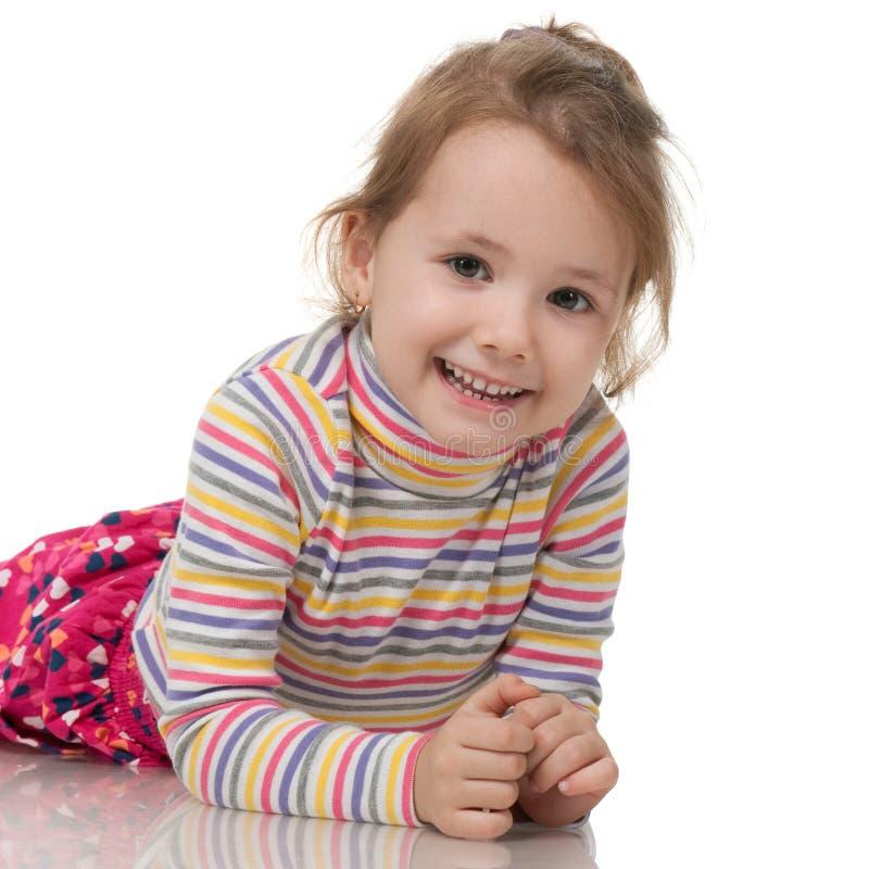 Bambina in maglione a strisce fotografia stock
