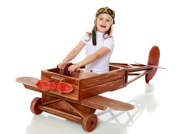 Bambina nel cappuccio del pilota fotografia stock libera da diritti