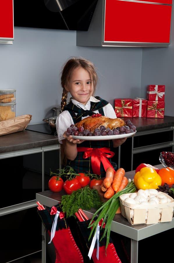 Bambina nella cucina fotografia stock