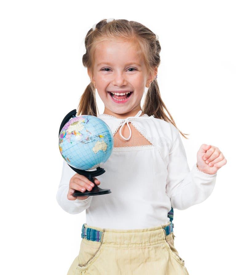 Bambina sorridente con il globo immagine stock libera da diritti