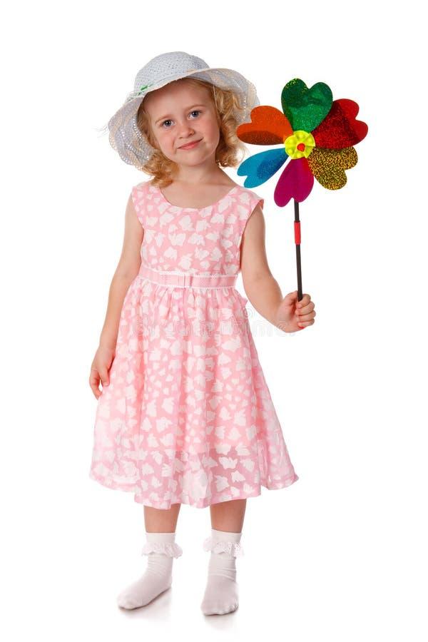 Bambina sorridente con il mulino a vento immagine stock