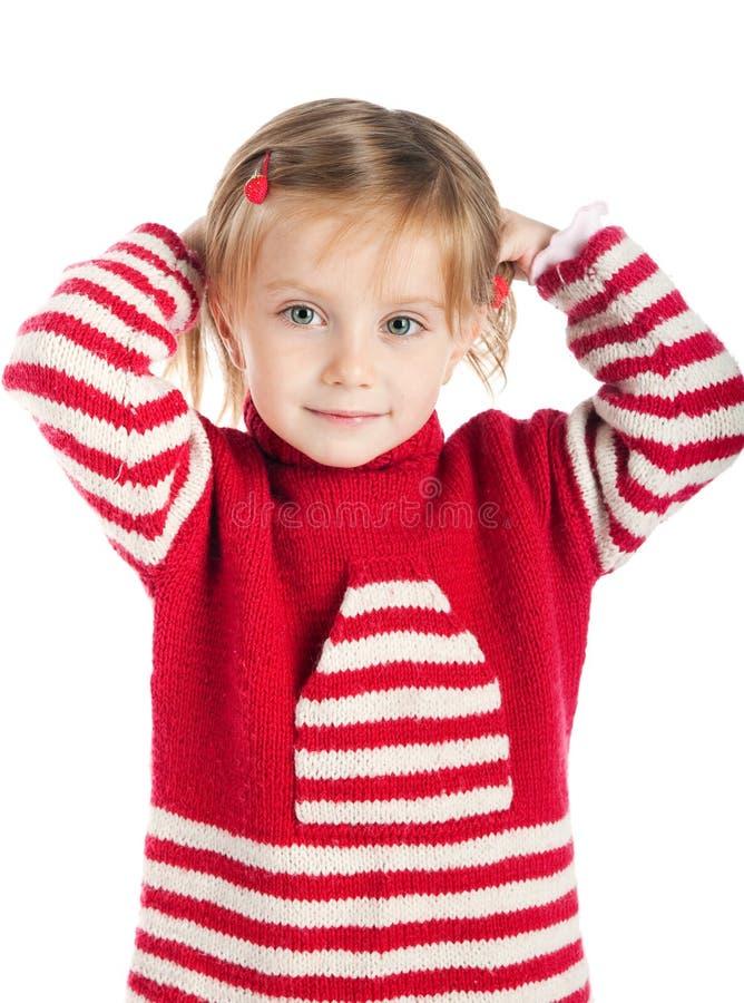 Bambina sul maglione a strisce immagini stock