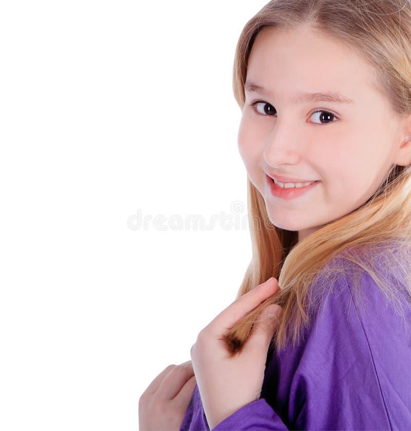Bambina sveglia che sorride sopra il bianco fotografia stock