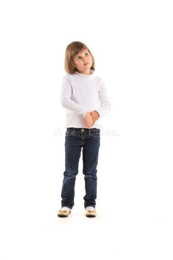 Bambina sveglia con l'espressione domandantesi del fronte immagini stock