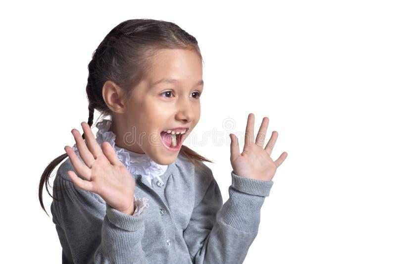 Bambina sveglia sorpresa isolata su fondo bianco immagini stock libere da diritti