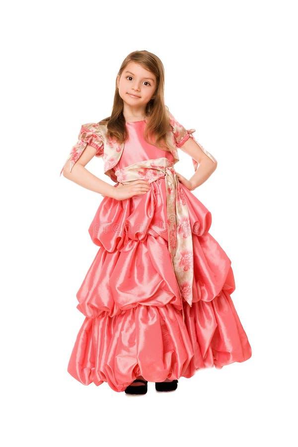 Bambina sveglia in un vestito lungo fotografia stock libera da diritti