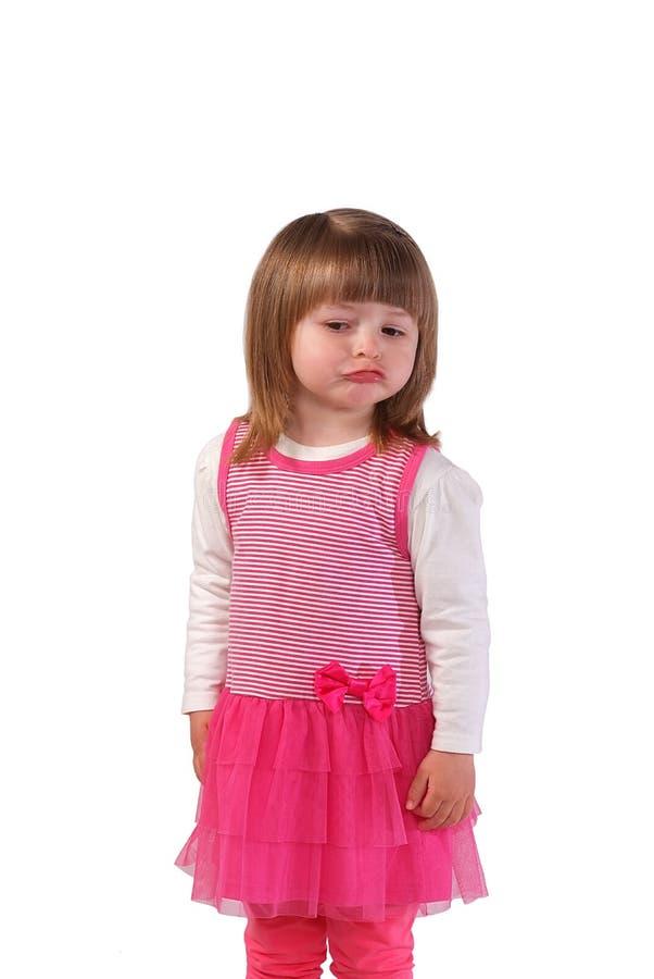 Bambina sveglia in un vestito rosa immagine stock libera da diritti