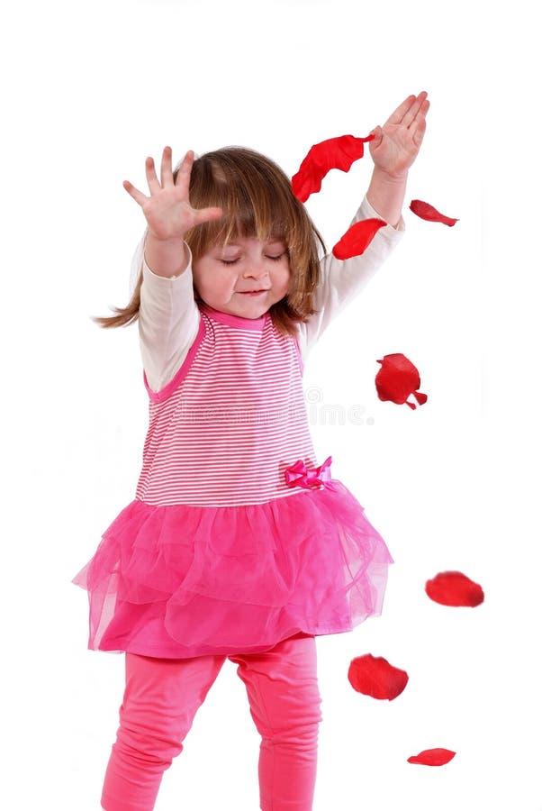 Bambina sveglia in un vestito rosa fotografia stock