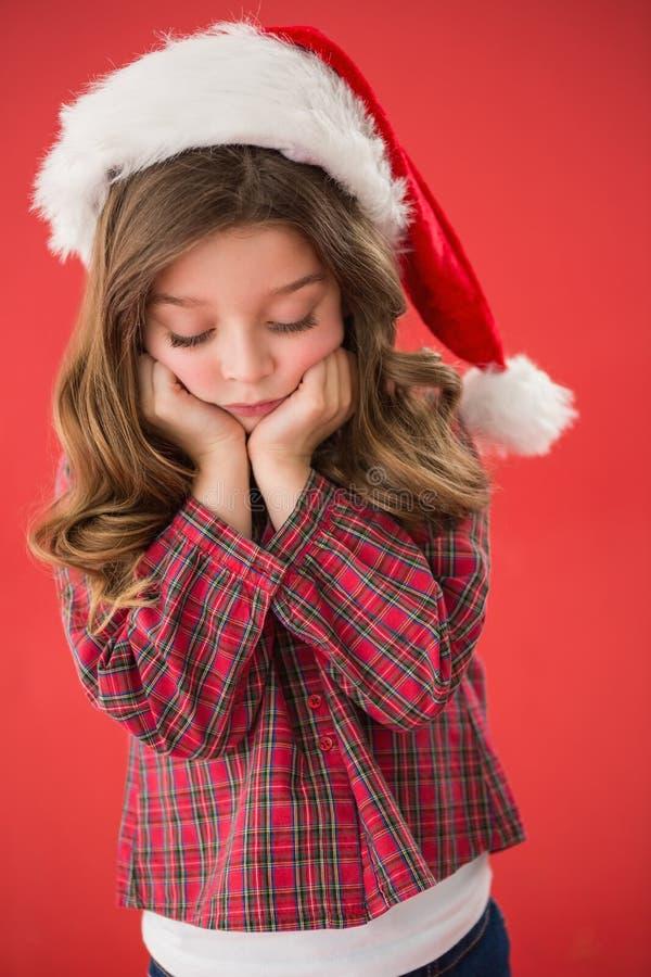 Bambina triste in cappello di Santa fotografie stock