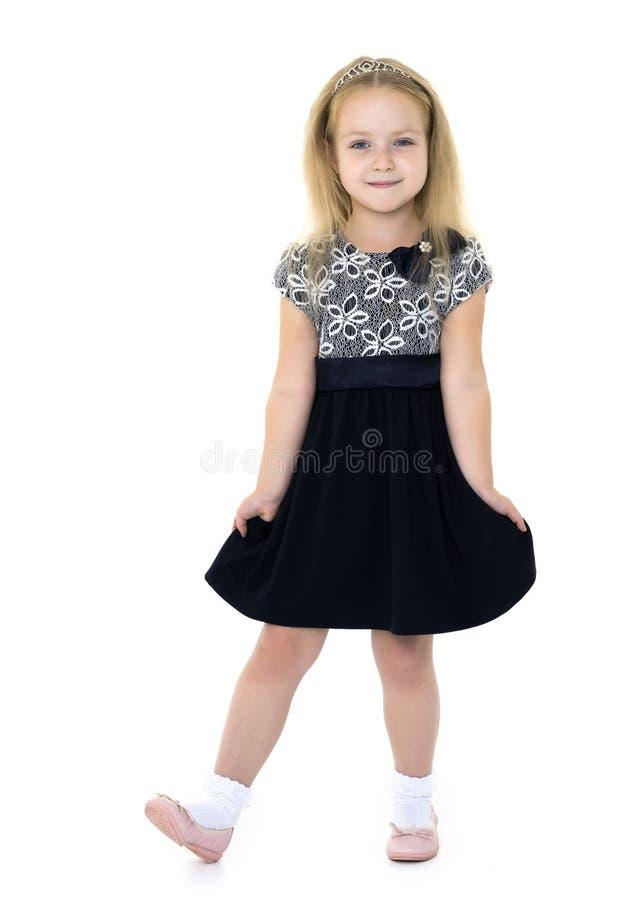 Bambina in un vestito elegante immagine stock libera da diritti