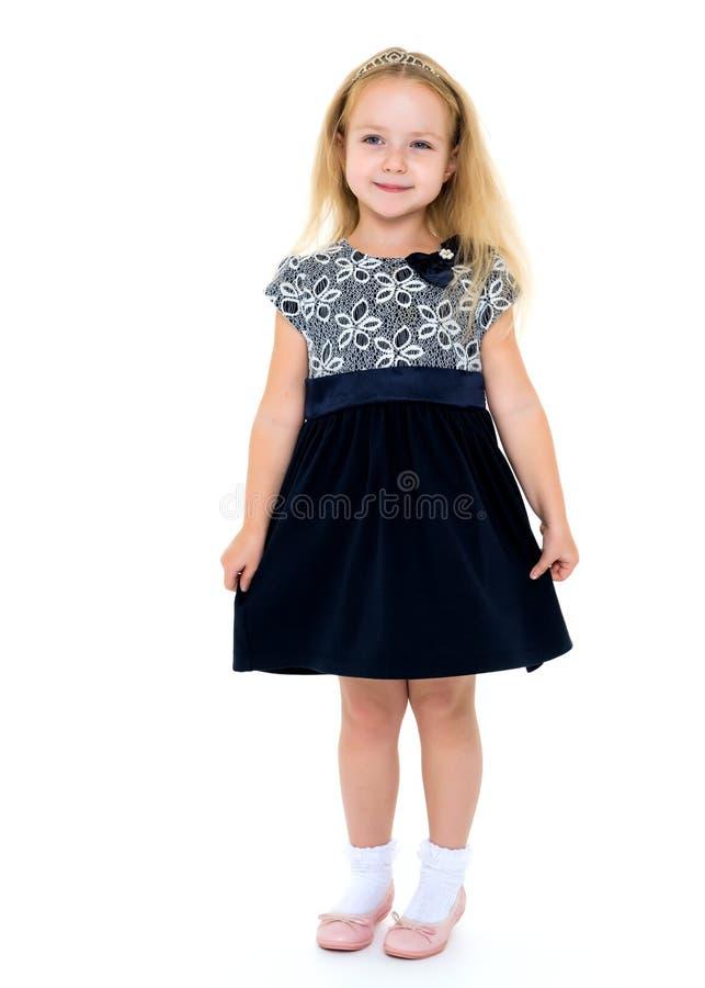 Bambina in un vestito elegante fotografie stock
