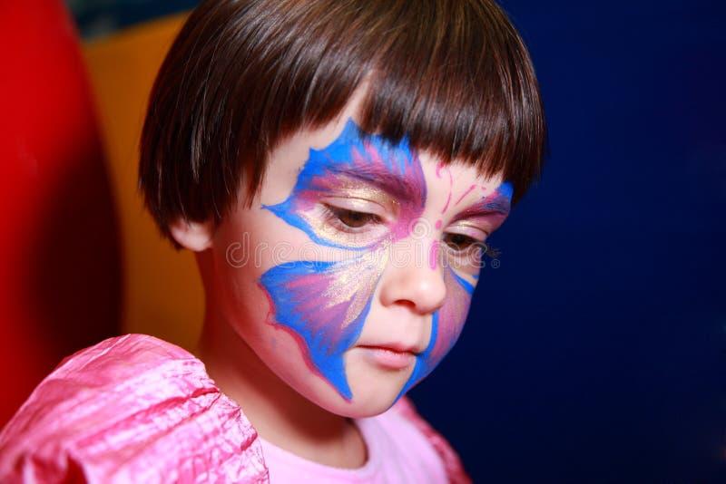 Bambina verniciata per la festa immagine stock libera da diritti