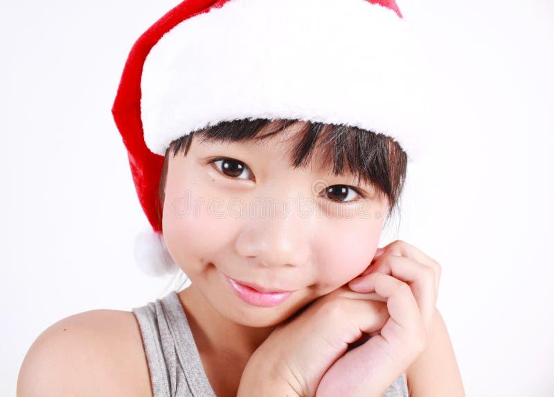 Bambina vestita come il Babbo Natale fotografia stock
