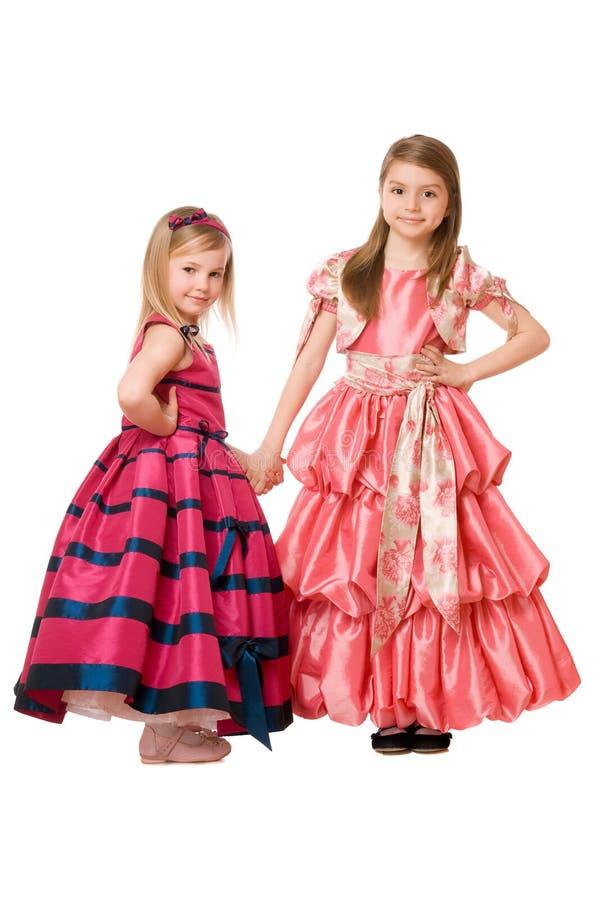 Bambine in un vestito lungo fotografie stock libere da diritti