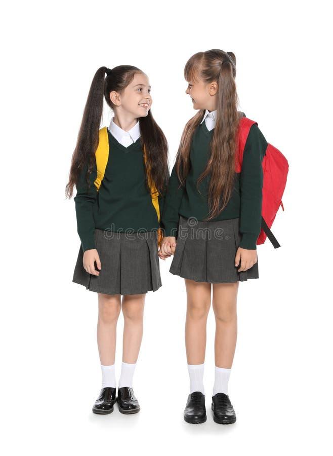 Bambine in uniforme scolastico alla moda immagine stock libera da diritti