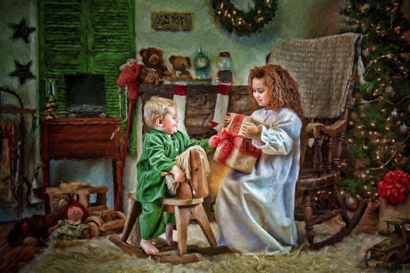 Bambini che aprono i regali di Natale immagine stock