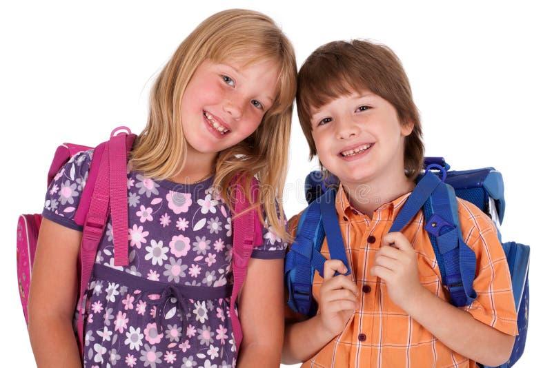 Bambini che propongono per di nuovo al tema del banco fotografie stock