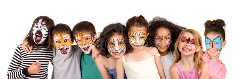 Bambini con fronte-pittura immagine stock libera da diritti