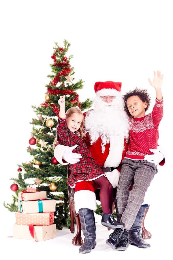 Bambini con Santa Claus fotografia stock