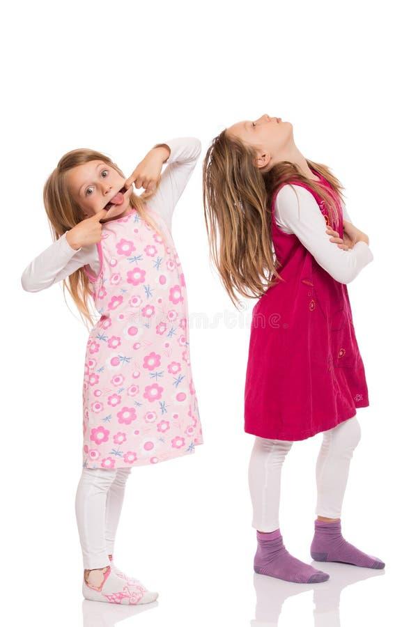 Bambini divertenti che fanno fronte immagini stock libere da diritti