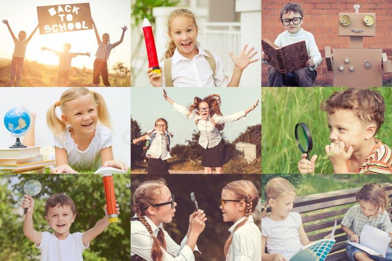 Bambini felici che giocano all'aperto al tempo di giorno fotografia stock libera da diritti