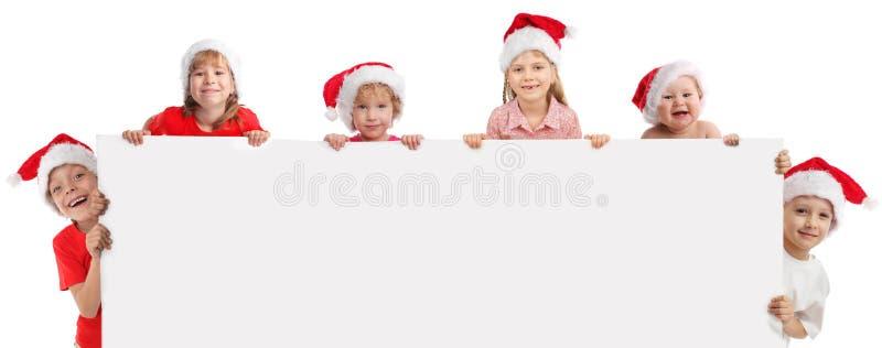 Bambini felici che tengono la bandiera in sua mano immagini stock