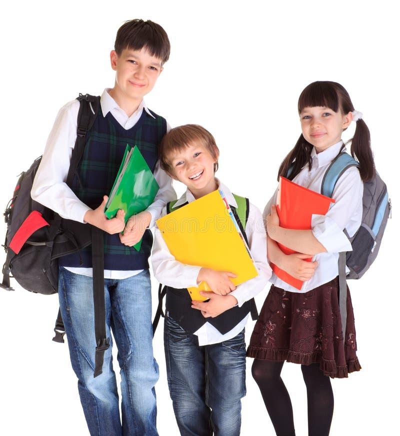 Bambini felici che vanno al banco fotografia stock libera da diritti