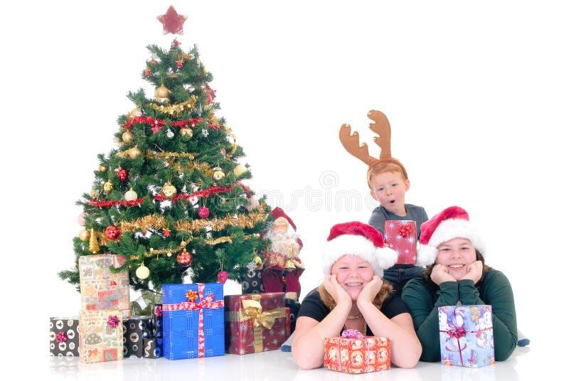Bambini intorno a natale tre fotografie stock