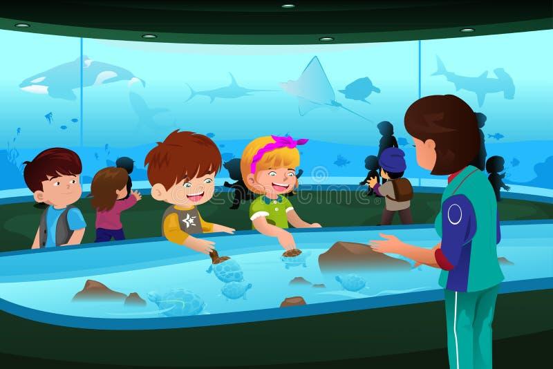 Bambini sull'escursione all'acquario illustrazione di stock