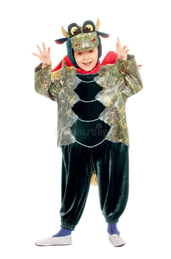 Bambino allegro in un costume del drago fotografie stock libere da diritti