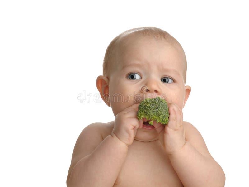 Bambino in buona salute con broccolo fotografie stock