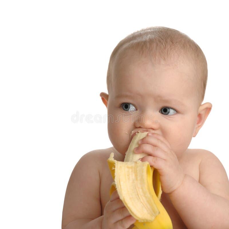 Bambino in buona salute con la banana immagine stock