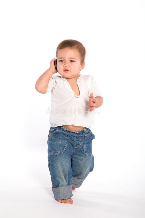 Bambino casuale con il telefono fotografia stock